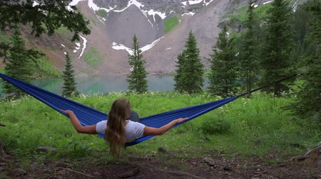 Girl rests on a Hammock looks at Dallas Peak near Lower Blue Lake Ridgway Colorado Стоковые видеозаписи