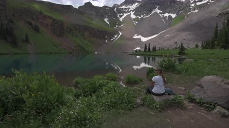 Backpacker Girl looks at Lower Blue Lake  Ridgway Colorado