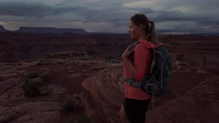 moab : Backpacker Girl looks at the beautiful canyon vista island in the sky and Maze district of the Canyonlands Stock Footage