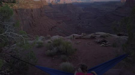 hamak : Hiker rests on a hammock admiring the sunset East Fork Shafer Canyon near Dead Horse Point State Park Canyonlands Utah USA