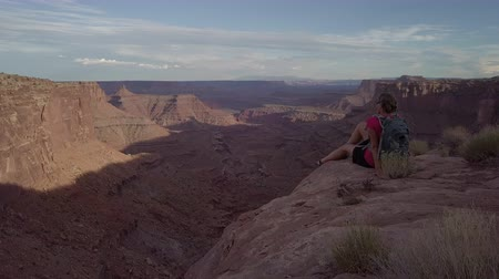 moab : Hiker at Marlboro Point East Fork Shafer Canyon near Dead Horse Point State Park Canyonlands Utah USA Stock Footage