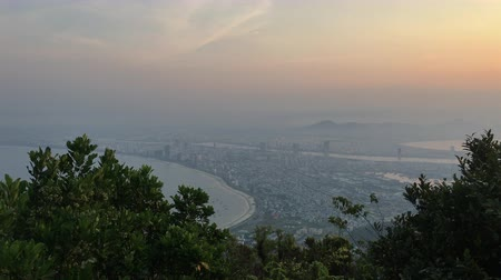 Beautiful sunset over The Da Nang Bay and Ba Na Hills as seen Ban Co Peak, Da Nang Vietnam