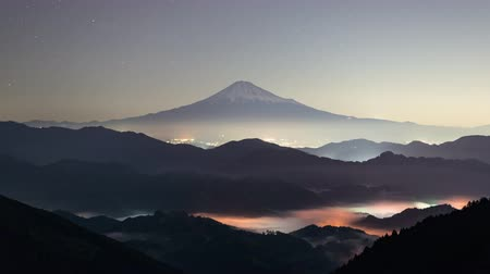 fujiyama : Mt. Fuji over a Iridescent Sea of Clouds at Night