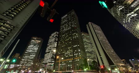 busz : Urban Skyline in Shinjuku Tokyo at Night (tilt down) Stock mozgókép