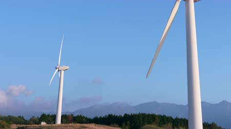 resourceful : Wind Turbine Turning around against the Blue Sky