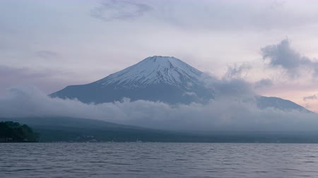 lakeshore : Mt. Fuji over Lake Yamanaka at Sunset (time lapsezoom in) Stock Footage