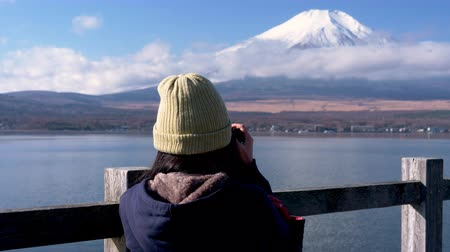 mt : Asian Woman Taking a Photo of Mt. Fuji with her DSLR Stock Footage