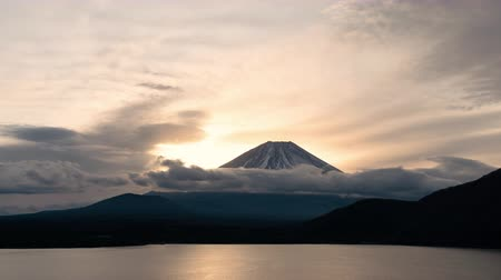 trave : Mt. Fuji over Lake Motosu at Sunrise: the view of Mt. Fuji over lake Motosu is famous for being printed on the back of the 1000 yen note (lapsepan time)