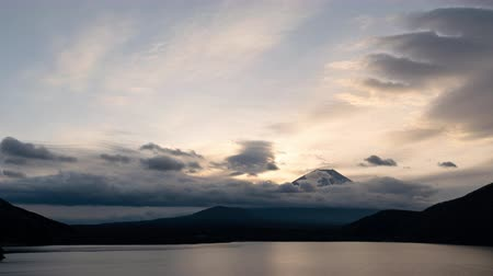 mt : Mt. Fuji over Lake Motosu at Sunrise: the view of Mt. Fuji over lake Motosu is famous for being printed on the back of the 1000 yen note (time lapse)