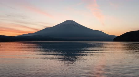 snowcapped : Mt. Fuji over Lake Yamanaka at Sunset (time lapsezoom in) Stock Footage
