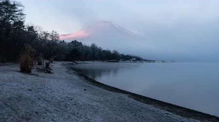 mt : Mt. Fuji Emerging from the Fog in the Morning (Time Lapse) Stock Footage