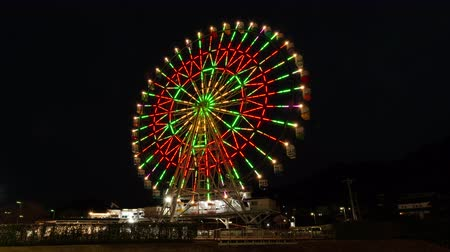 built structure : Illuminated Ferris Wheel Turning around against the Night Sky (time lapse)