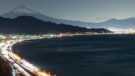 mt : Mt. Fuji over the Tomei Expressways and Suruga Bay (time lapsepan) Stock Footage