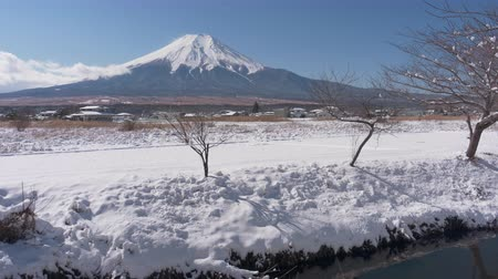 mt : Mt. Fuji over Snowy Fields in Winter (time lapsezoom in)