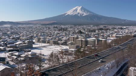 mevcut : Mt. Fuji over the Highways and Snowy Town (zoom in)