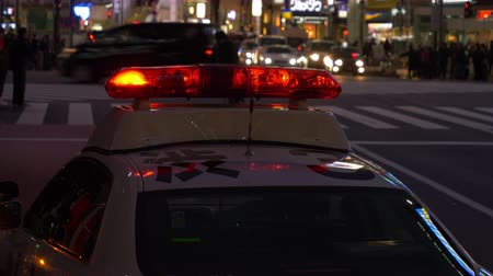 focus on foreground : Police Car Parked Near the Shibuya Crossing Stock Footage