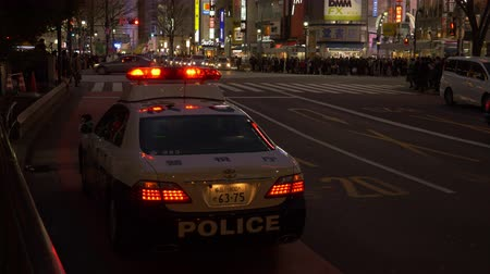 yaşama gücü : (EDITORIAL) Shibuya Ward, TokyoJapan-February 12, 2019: A police car parked near the Shibuya Crossing. Theres a police box right next to the car in the left.