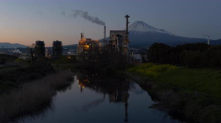 canola : Mt. Fuji and a Factory Reflected in a River