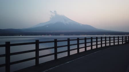 lakeshore : Walking Toward Mt. Fuji at Dusk