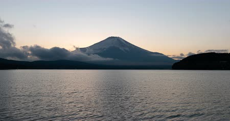 snowcapped : Mt. + Fuji + over + Lake + Yamanaka + at + Sunset +% 28time + lapse% 2Ftilt + up% 29 Stock Footage