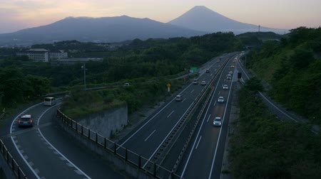 mevcut : Mt. + Fuji + over + Highways + at + Dusk +% 28zoom + in% 29 Stok Video