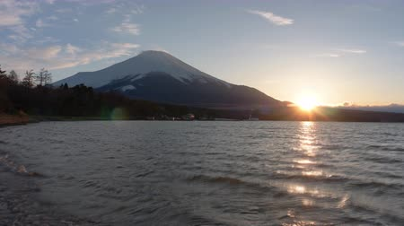snowcapped : The Sun Sets over Lake Yamanaka and Mt. Fuji (Time Lapse) Stock Footage
