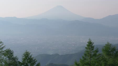 lookout point : Mt. Fuji over the Kofu Basin from Mt. Amari in a Sunny Spring Morning (real time  audio  tilt down) Stock Footage