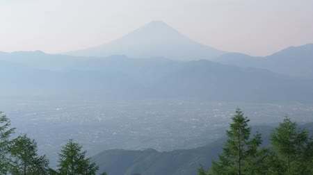 tilt down : Mt. Fuji over the Kofu Basin from Mt. Amari in a Sunny Spring Morning (time lapsetilt down)