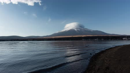 lakeshore : Mt. Fuji with Lenticular Clouds (time lapsezoom out) Stock Footage