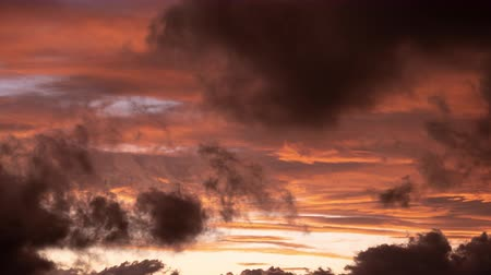 tilt down : Time Lapse Footage of Clouds Captured at Sunset (tilt down) Stock Footage