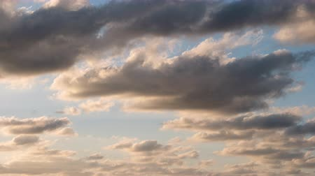 tilt down : Clouds Getting Orange in a Sky at Sunset (time lapsetilt down) Stock Footage
