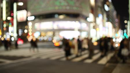 ginza : Bokehed City Lights at a Crossing in a Big City at Night (time lapse) Stock Footage