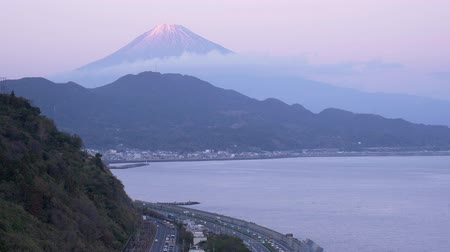 tilt down : Mt. Fuji over the Tomei Expressway and Bay (time lapsetilt down)
