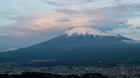 snowcapped : Mt. Fuji with Lenticular Clouds over the City of Fujinomiya at Sunset (time lapse)