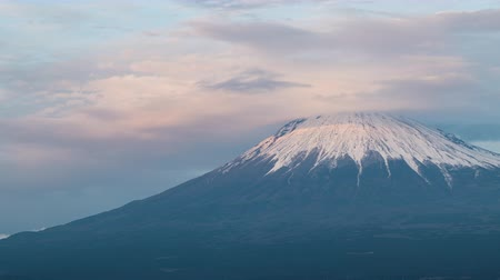 snowcapped : Mt. Fuji with Lenticular Clouds at Sunset (time lapsepanning) Stock Footage