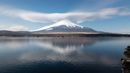 lakeshore : Mt. Fuji with a Huge Lenticular Cloud Reflected in Lake Yamanaka (Time Lapse) Stock Footage