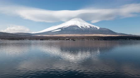 Mt. Fuji with a Huge Lenticular Cloud Reflected in Lake Yamanaka (time lapsezoom in) Stock Footage