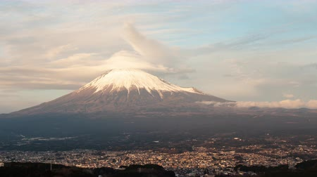 tilt down : Mt. Fuji with Lenticular Clouds over the City of Fujinomiya at Sunset (time lapspanning)