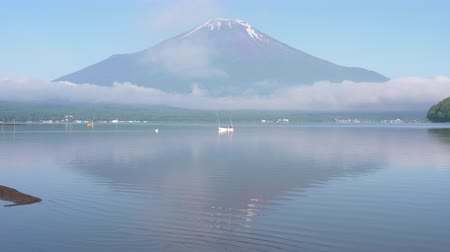 Mt. Fuji Reflected in Lake Yamanaka in a Foggy Morning in Summer (time lapse)