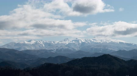 lookout point : Snowy Mountains over a Town (time lapsezoom out): Mt. Ontake from Hida Takayama City, Gifu Pref., Japan