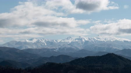 Snowy Mountains over a Town (time lapsePanning): Mt. Ontake from Takayama City, Gifu Pref., Japan Stock Footage