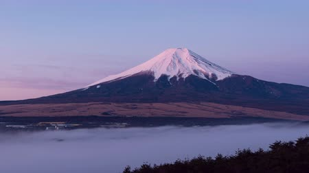Mt. Fuji over a Sea of Clouds at DawnSunrise (Time LapseZoom Out)