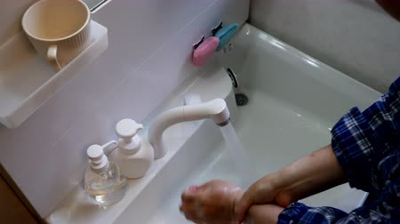 influenza : An Asian Man Washing His Hands Thoroughly and Gargles for Virus Prevention