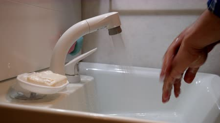 An Asian Man Washing His Hands for Virus Prevention