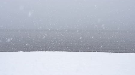 japonya : Snowing at a Lake in Winter (Super Slow Motion) Stok Video
