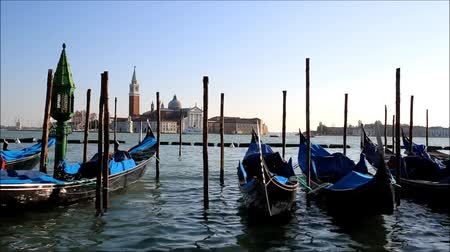 Острова : Venice with gondolas on Grand Canal against San Giorgio Maggiore church