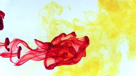 yellow ink : Red and yellow ink in water