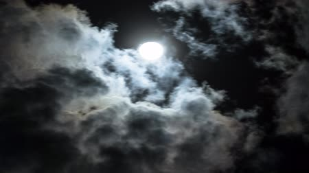 готический : Amazing night sky with shining full moon behind moving dramatic clouds. Time lapse