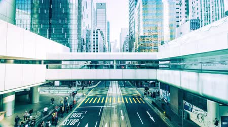 kalabalık : Time lapse view of modern city crowded street with skyscrapers, cars and walking people. Hong Kong Stok Video