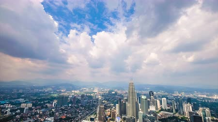 capital cities : Cloudscape view city panorama with Petronas Twin Towers at KLCC City Center. Malaysia. Time lapse